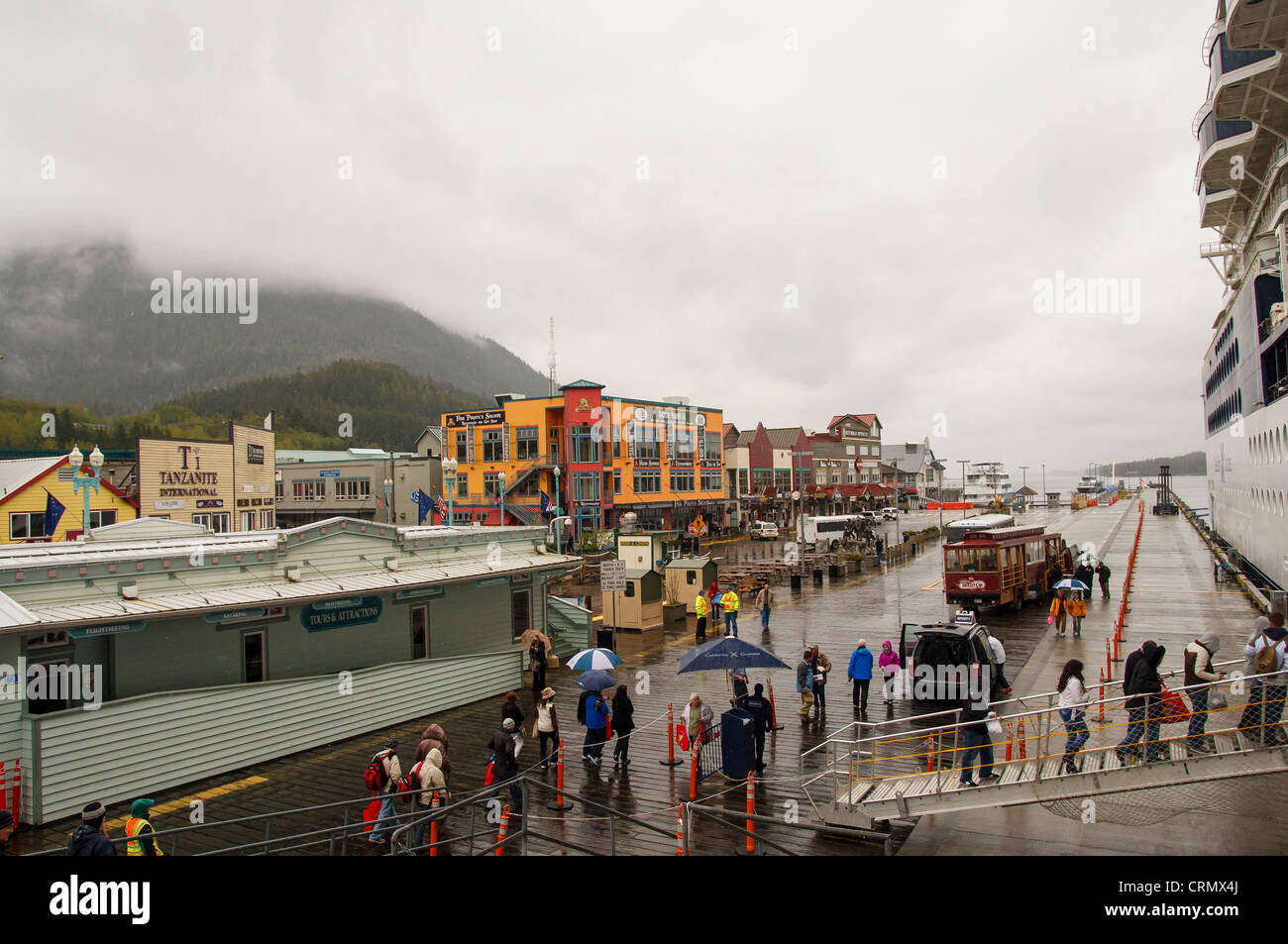 Passengers boarding a cruise ship in the rain at Ketchikan, Alaska Stock Photo