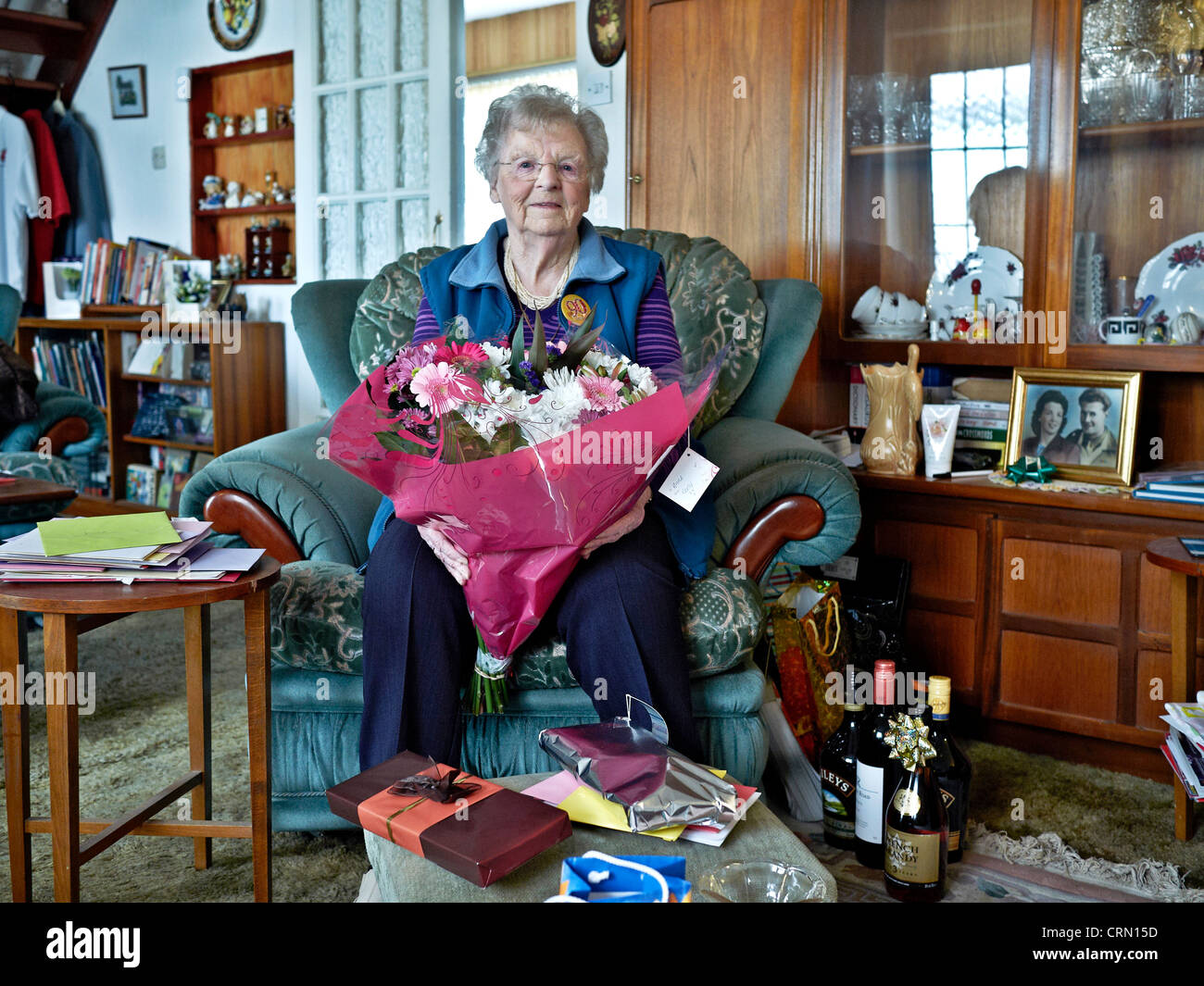 90 Year Old Senior At Home On Her Birthday Surrounded With Presents England UK Europe