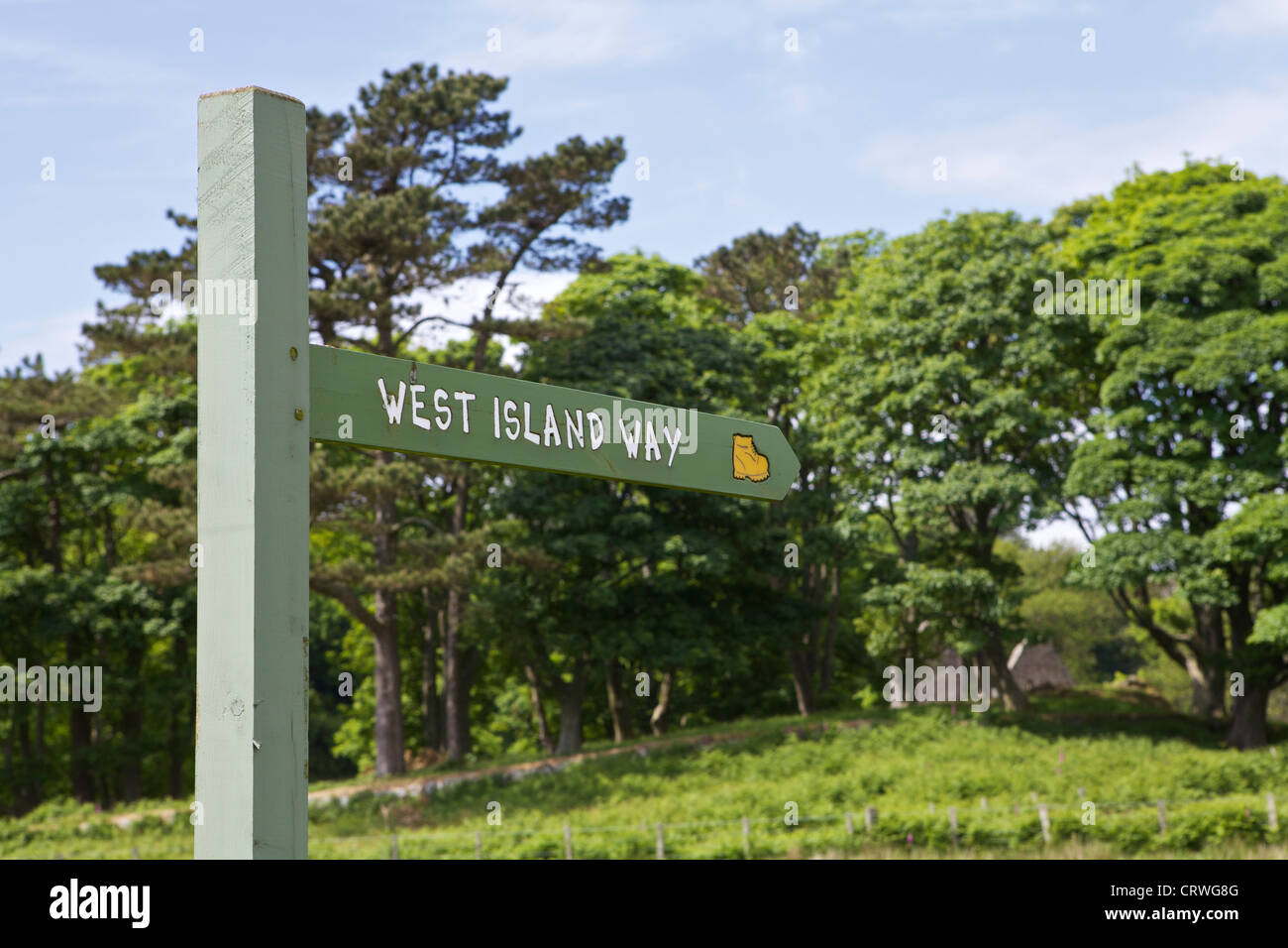 West Island way sign and St Blanes church visible in the trees - Stock Image