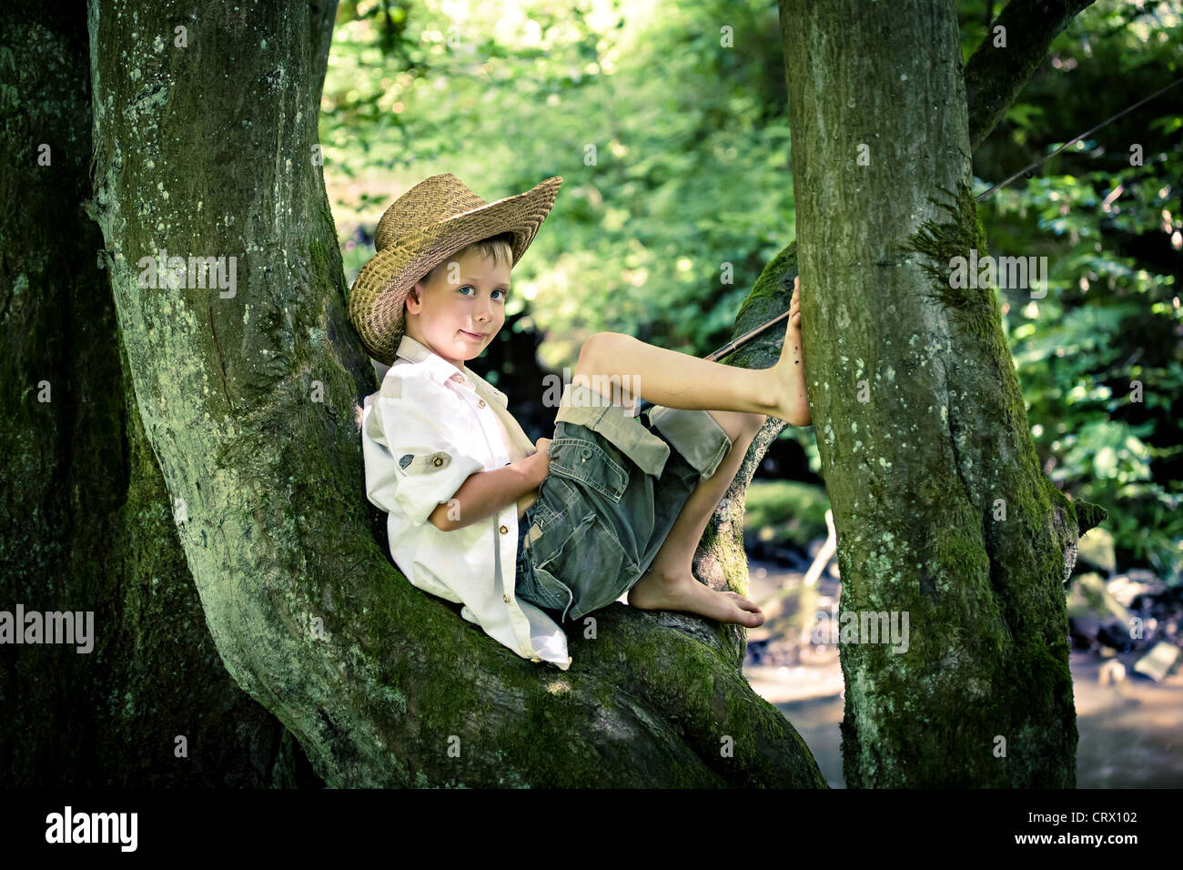 outdoor portrait of a young fishing boy - Stock Image