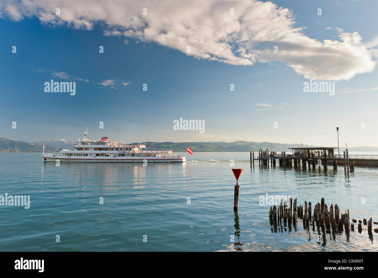 Germany, Wasserburg, View of ship departing from jetty - Stock Image