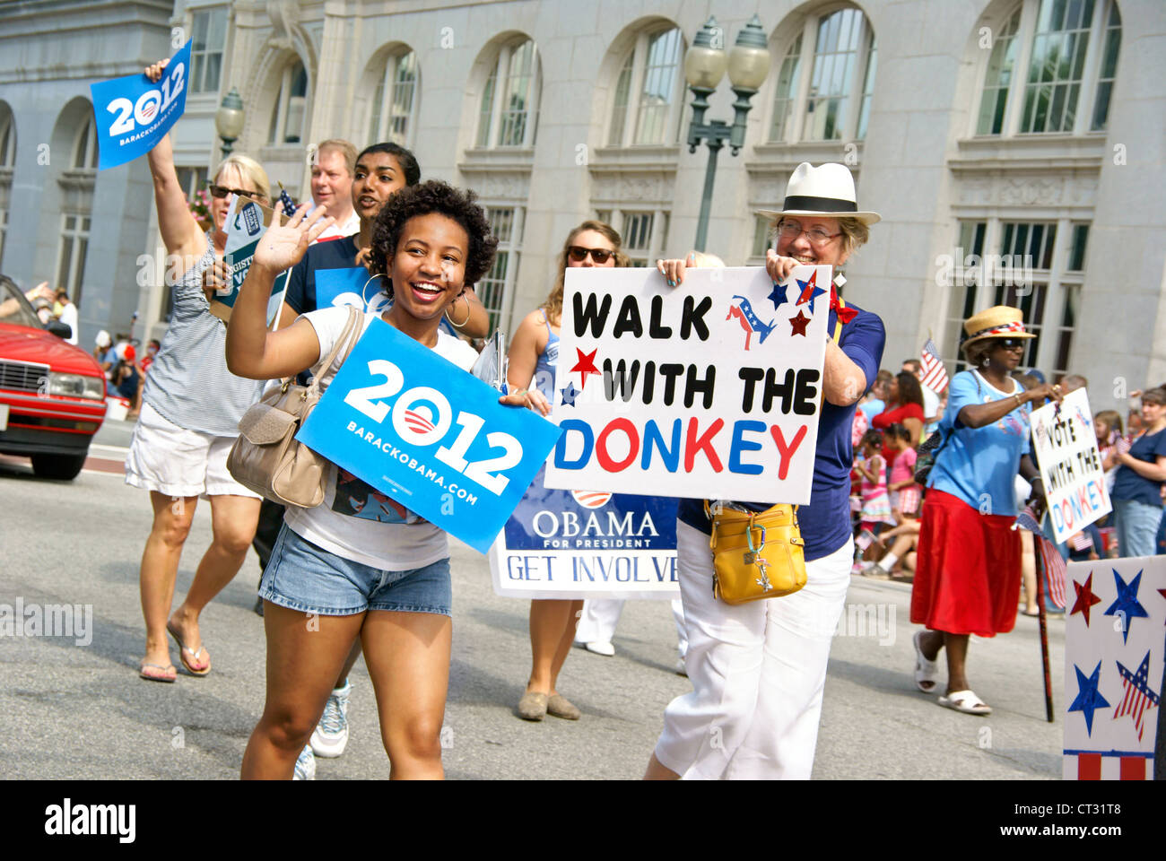 Democrats with Barack Obama signs participate in the 4th of July parade in Greensboro, North Carolina, NC Stock Photo
