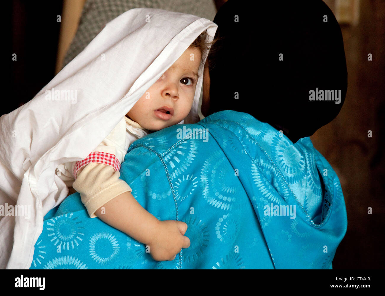 arab-baby-being-carried-by-mother-morocco-africa-CT4XJR.jpg