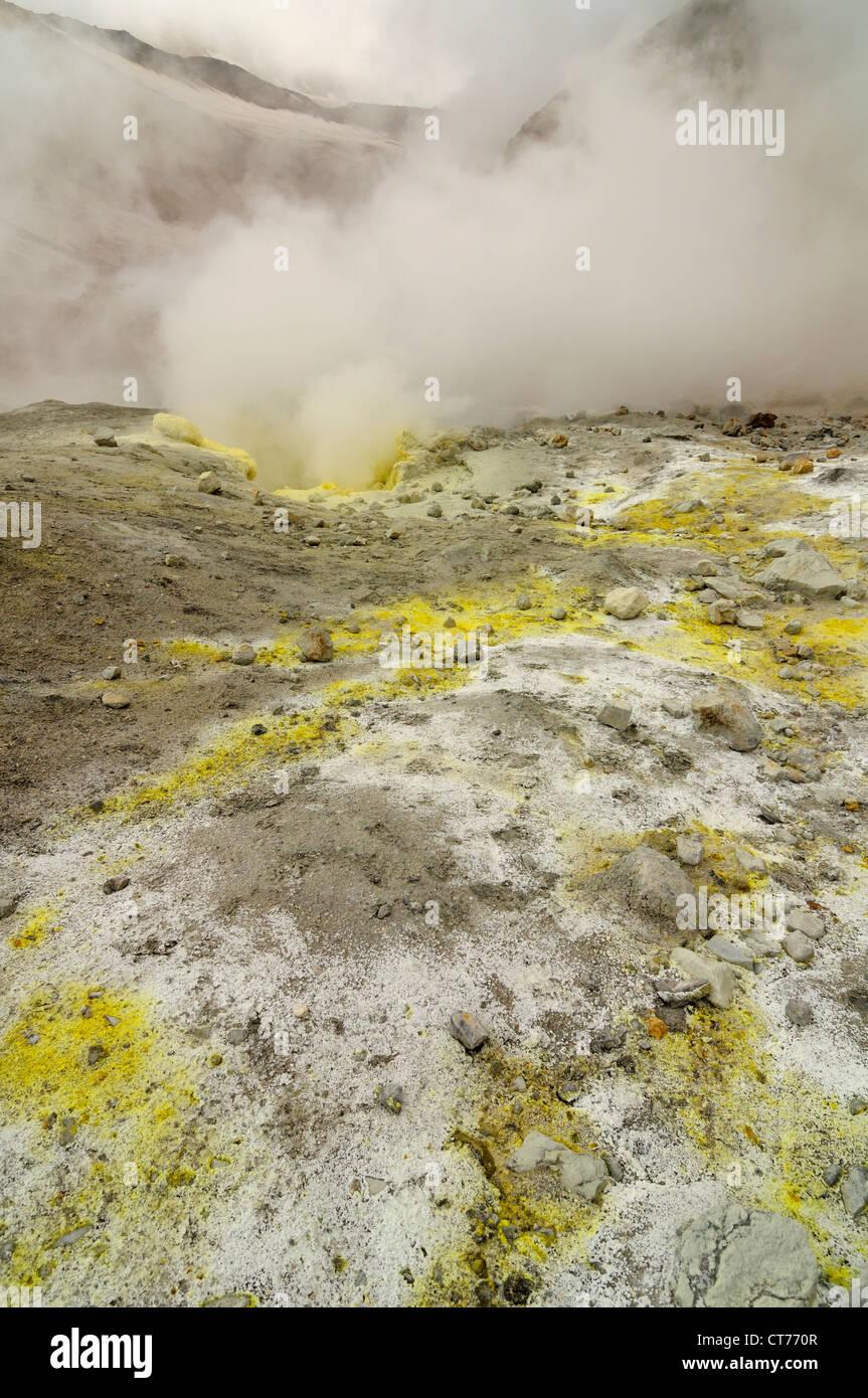 steam evaporating in Mutnovsky volcano area on Kamchatka - Stock Image