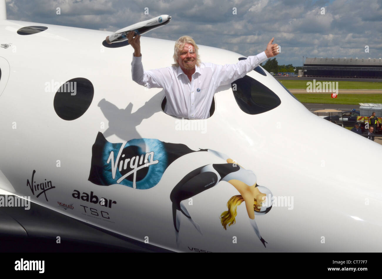 Sir Richard Branson, Founder of Virgin Galactic, with a model of LauncherOne in a replica of SpaceShipTwo. - Stock Image