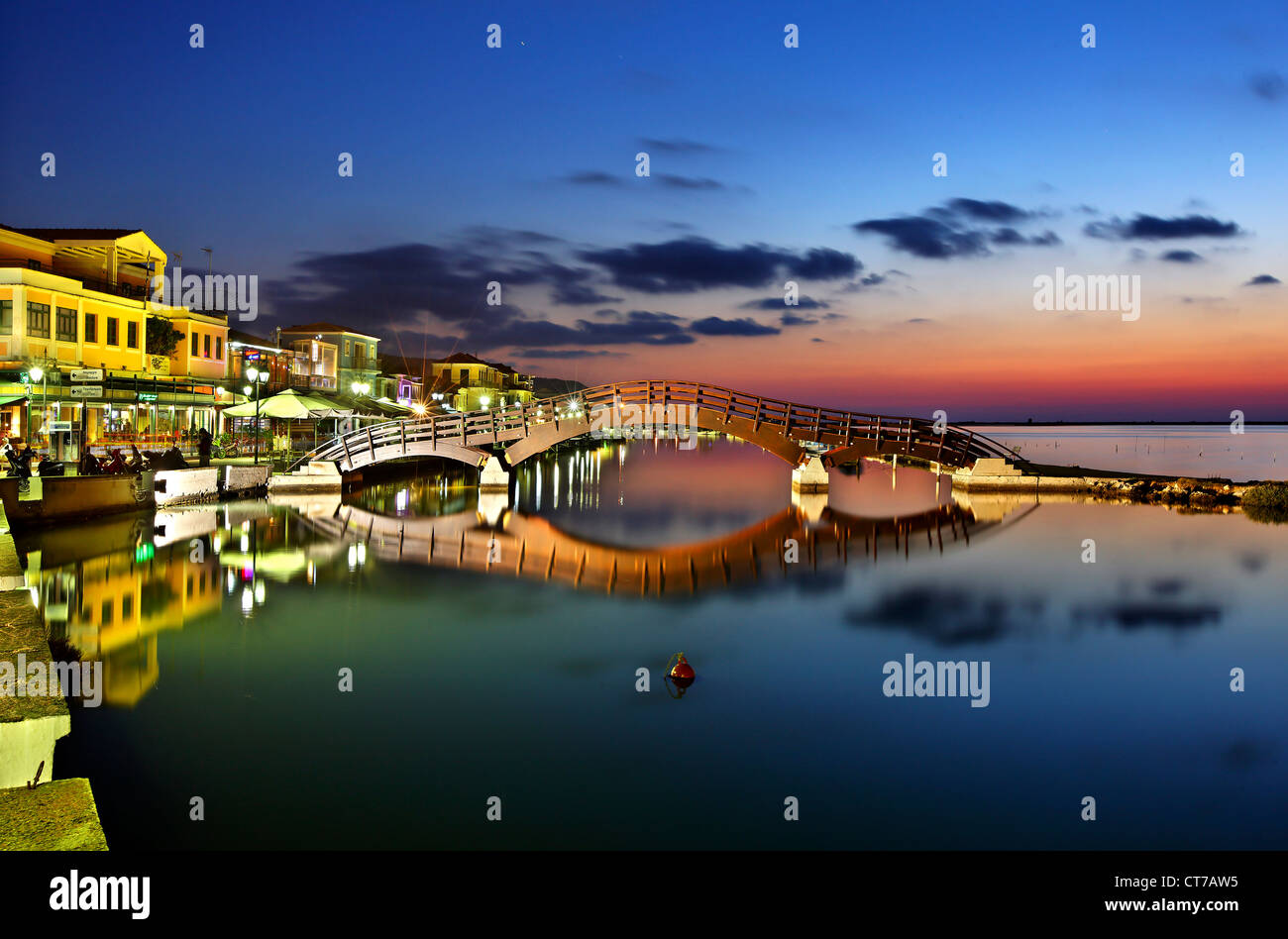 Sunset at Lefkas (Lefkada)  town, at the small marina for the fishing boats with the nice wooden bridge. Ionian - Stock Image