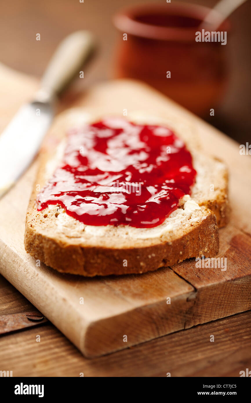 bread with strawberry jam - Stock Image