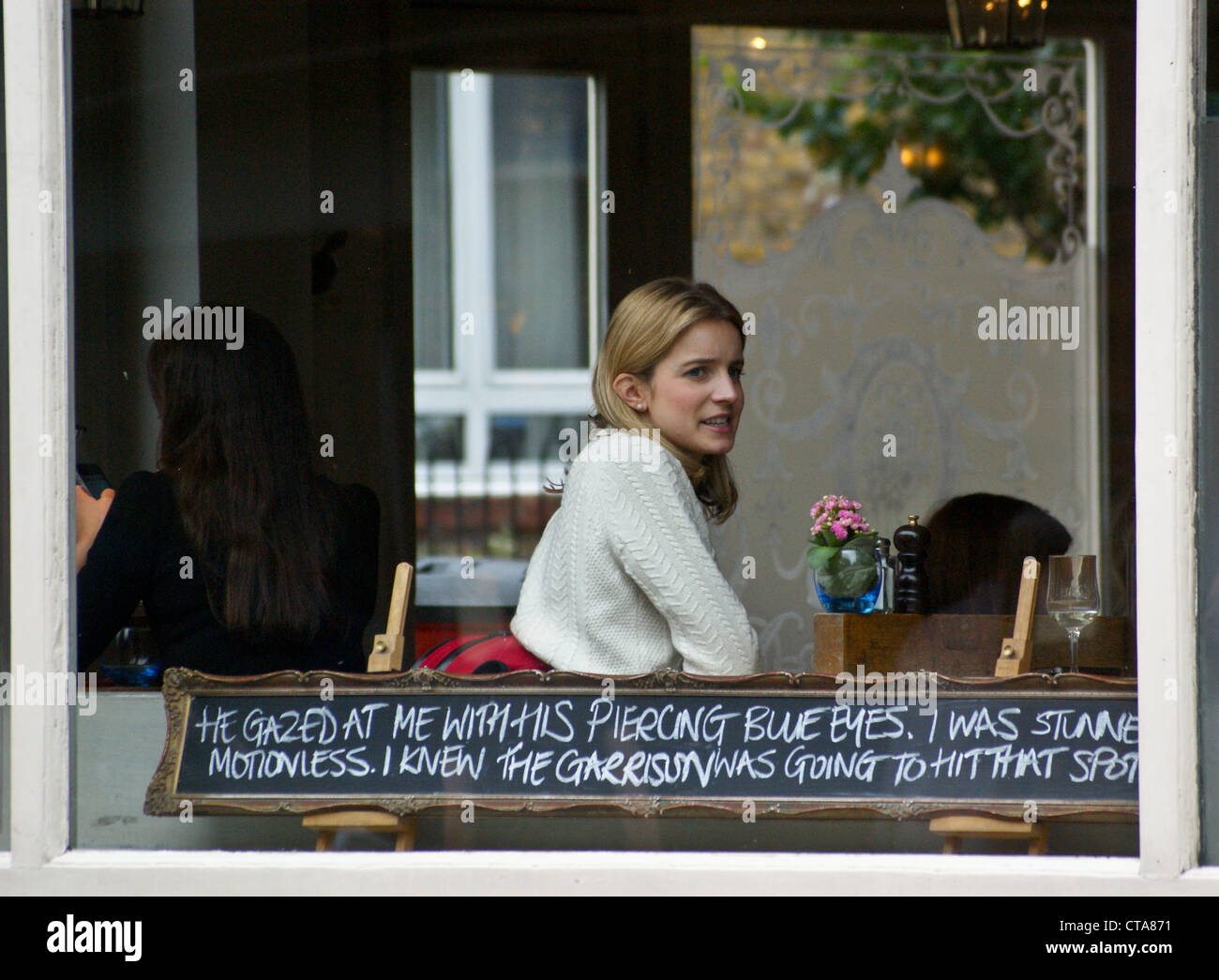 a-pretty-girl-at-a-pub-window-with-a-line-of-poetry-the-garrison-bermondsey-CTA871.jpg