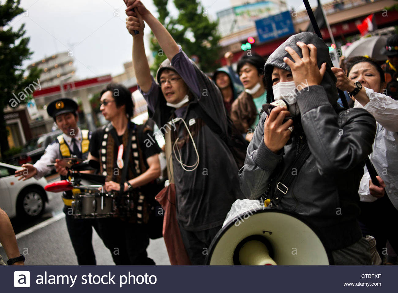 "Residents of Suginami hold a ""Zero Nuclear Power Celebration Parade"" in Koenji, Tokyo. Stock Photo"