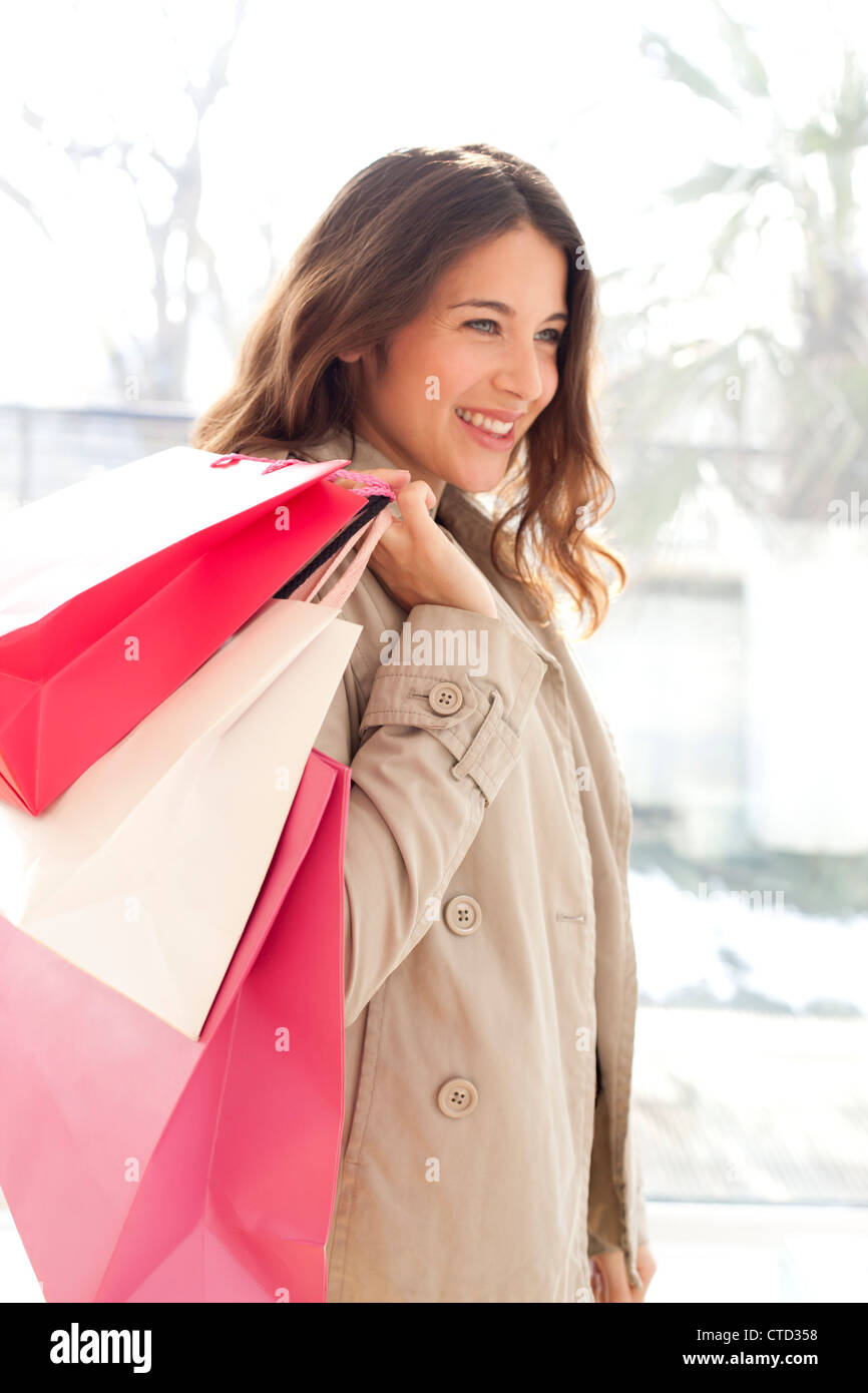Woman with shopping bags - Stock Image