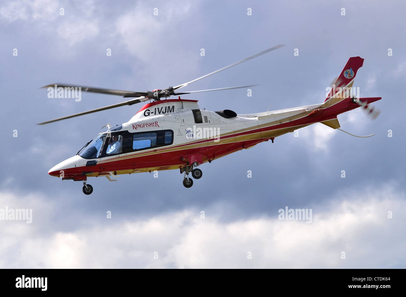 Agusta Westland AW109E Power helicopter operated by Kingfisher Airlines  departing Farnborough Airport, UK.