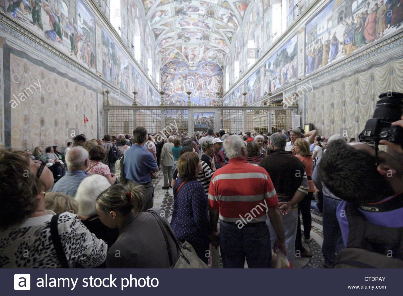 mass tourism inside the Sistine Chapel Rome Vatican Musem - Stock Image
