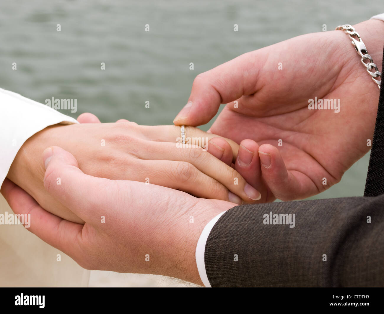 Closeup on exchange wedding rings of a young couple Stock Photo