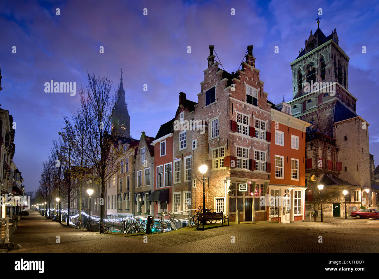 The Netherlands, Delft, Street and canal called Voldersgracht, where painter Johannes Vermeer used to live. Dawn. - Stock Image