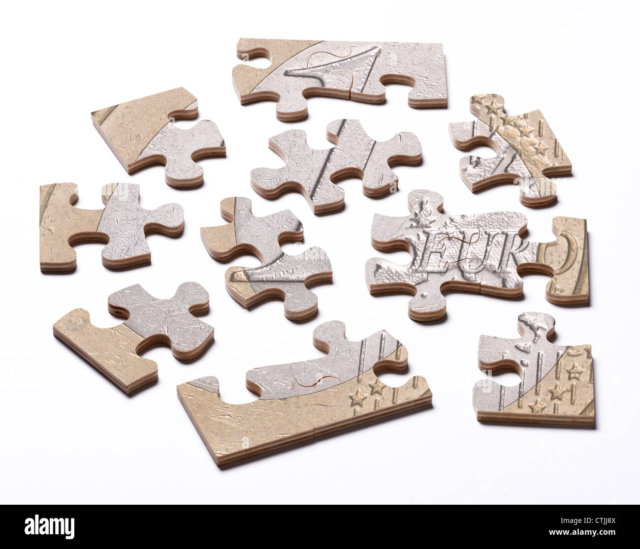 Euro coin on jigsaw pieces - Stock Image
