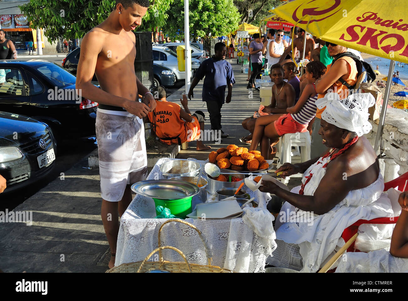 Salvador, Brazil, A local man buying Acaraje know as local soul food in the street. Stock Photo