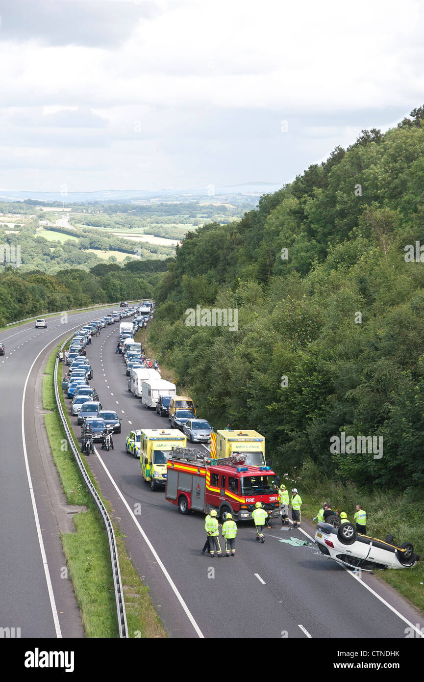 Accident scene on the A30 dual carriageway in Cornwall, where a car has overturned and the road blocked by emergency - Stock Image