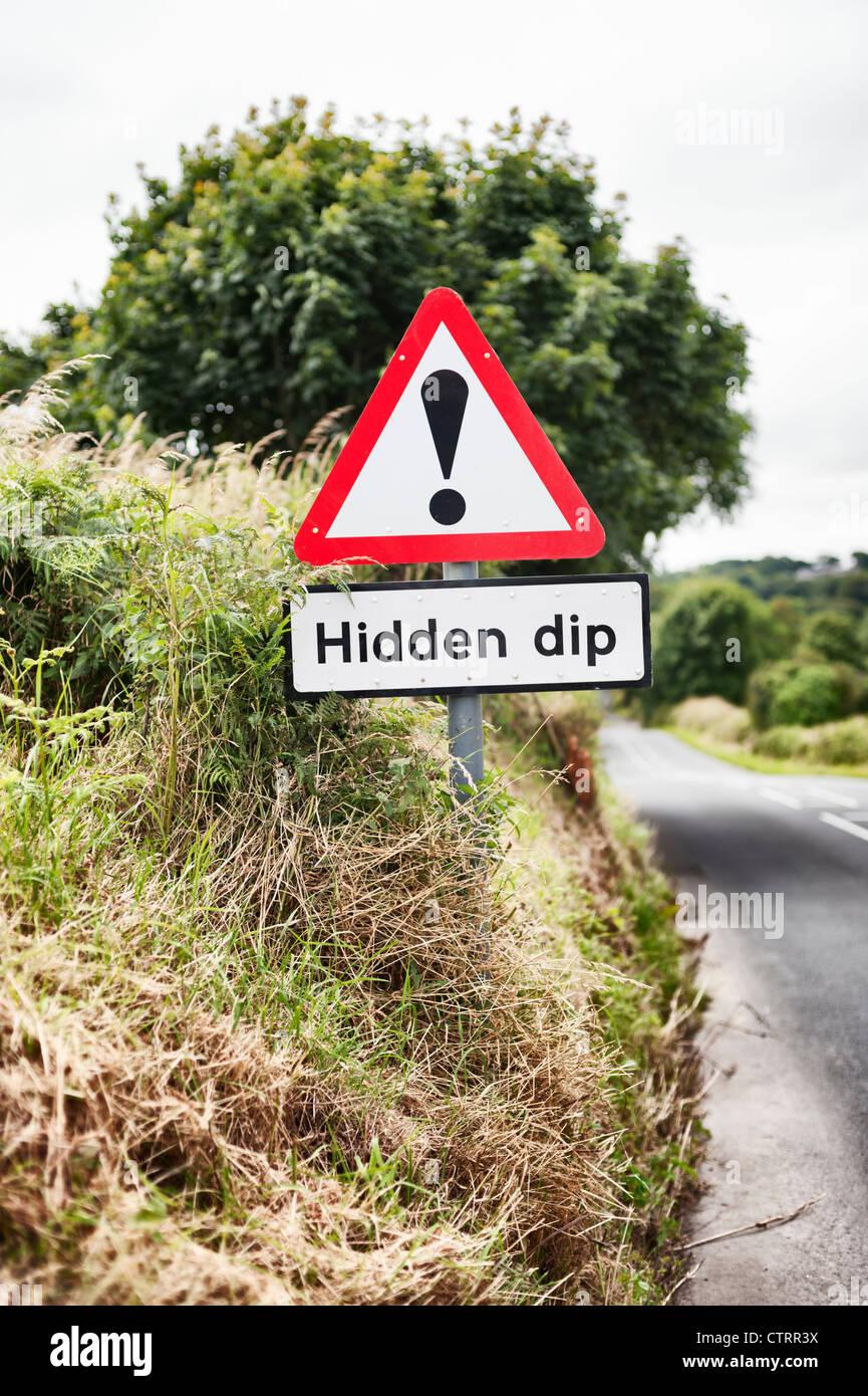 hidden dip - economy metaphor - Stock Image