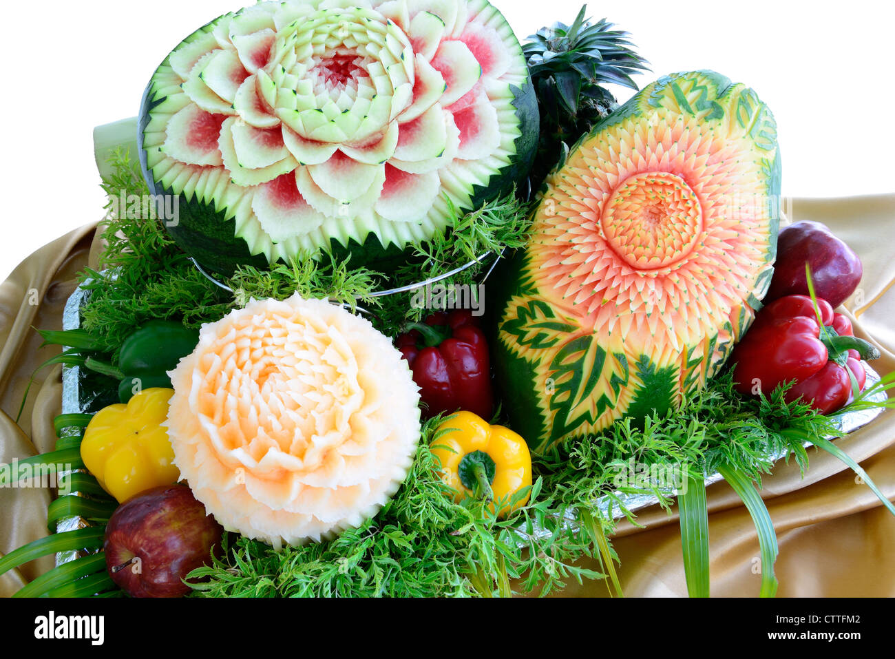 Fruit carvings by thai chef is on the buffet table isolated on white