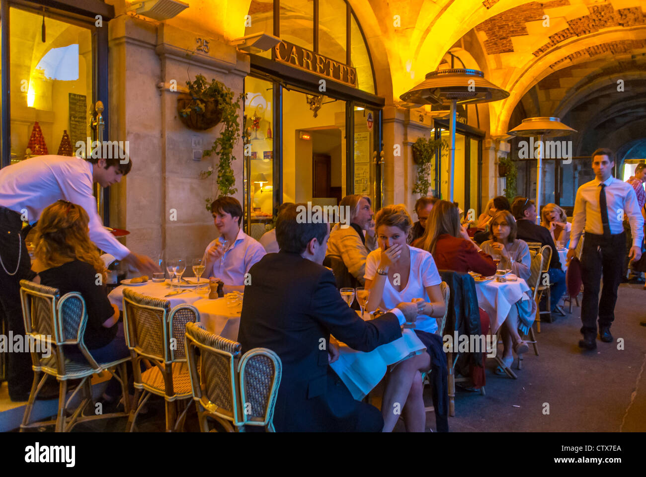 Paris France People Sharing Meals At French Bistro Café Stock