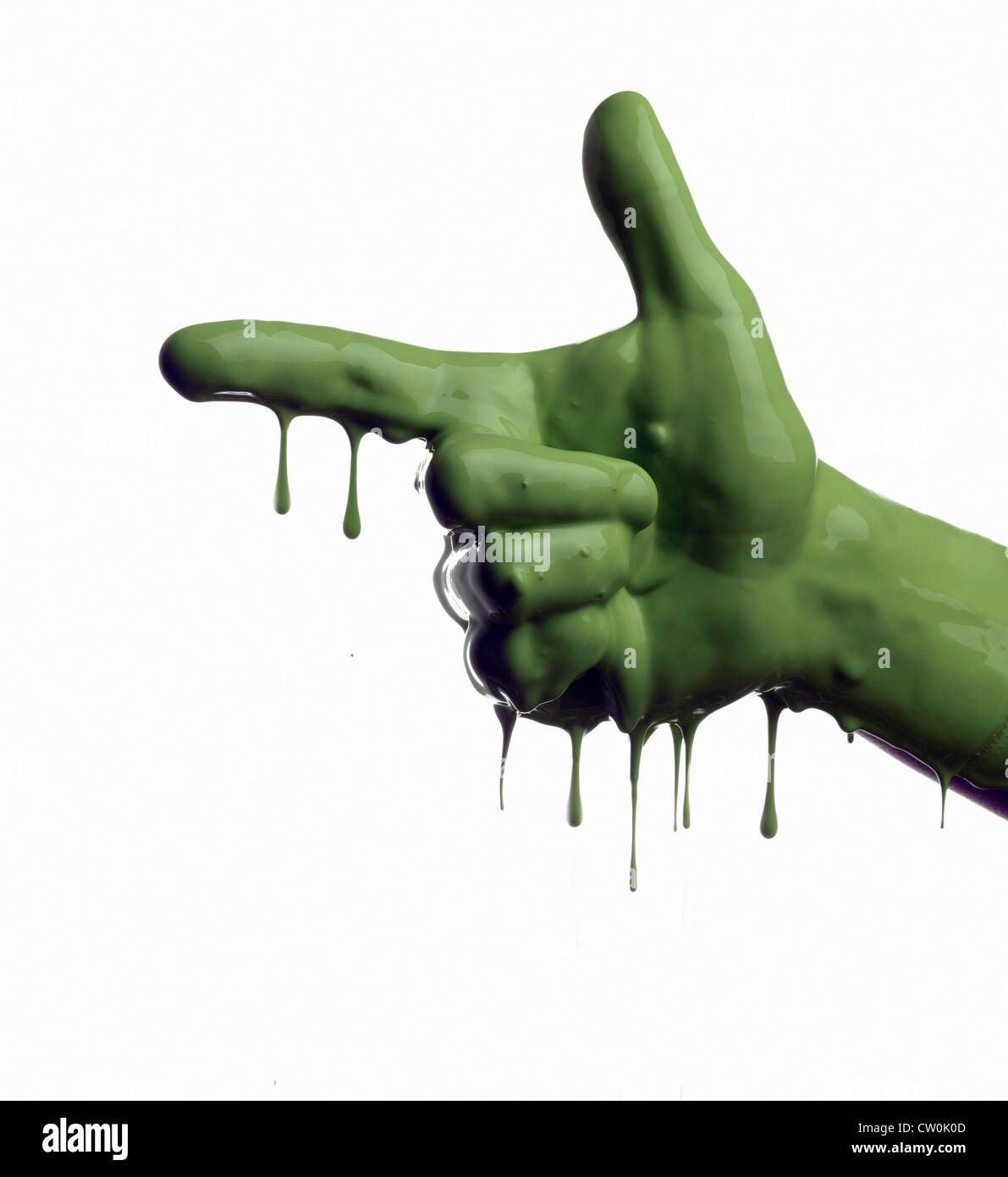 Green painted hand pointing - Stock Image