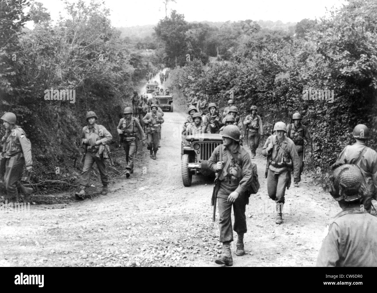 American troops pursue retreating Germans  in Normandy, Summer 1944 Stock Photo