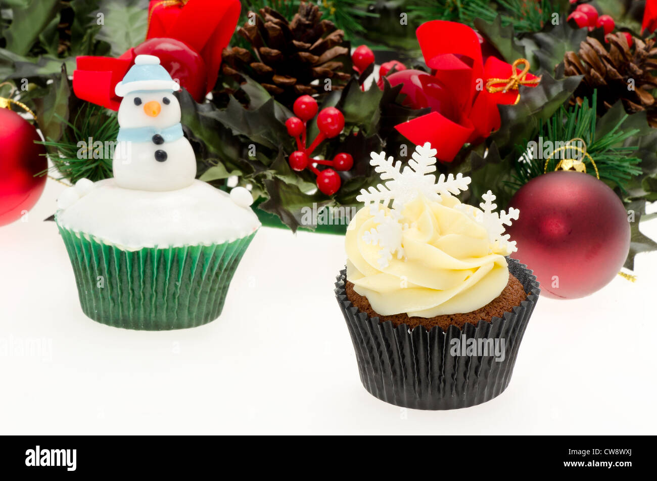 christmas cupcakes with decorations studio shot with a white background shallow depth of field - Christmas Cupcake Decorations