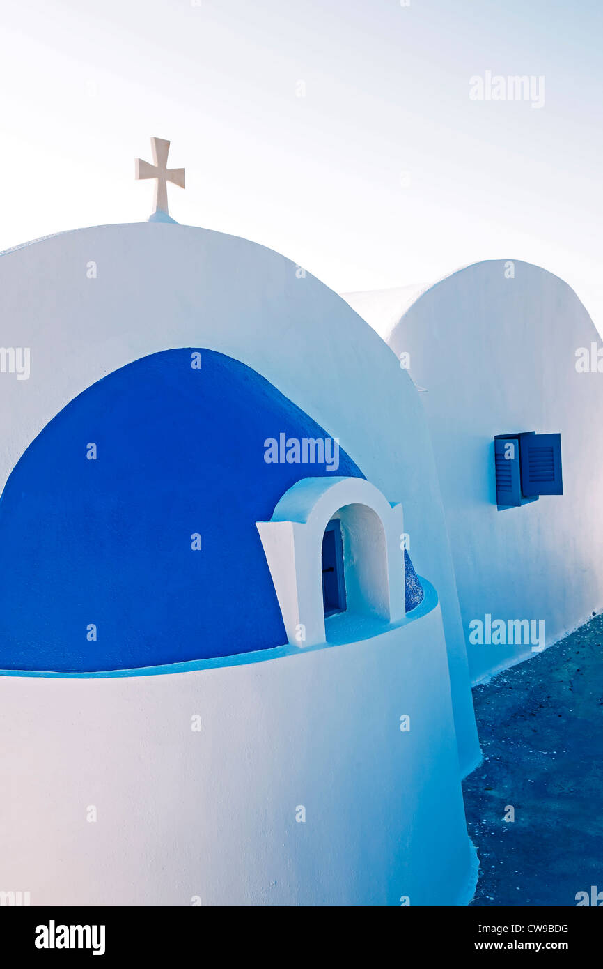 a private chapel in Greece with a dome, cross, and attached dwelling - Stock Image