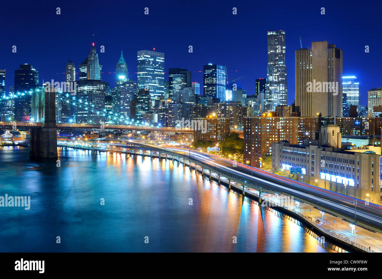 View of the financial district of Manhattan at night in New York City. - Stock Image