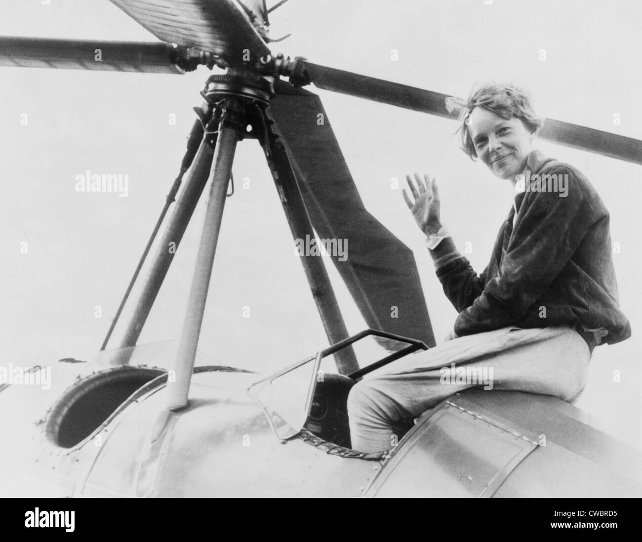 Amelia Earhart (1897-1937), waving, seated outside cockpit on top of an Autogiro, in Los Angeles, shortly after Stock Photo