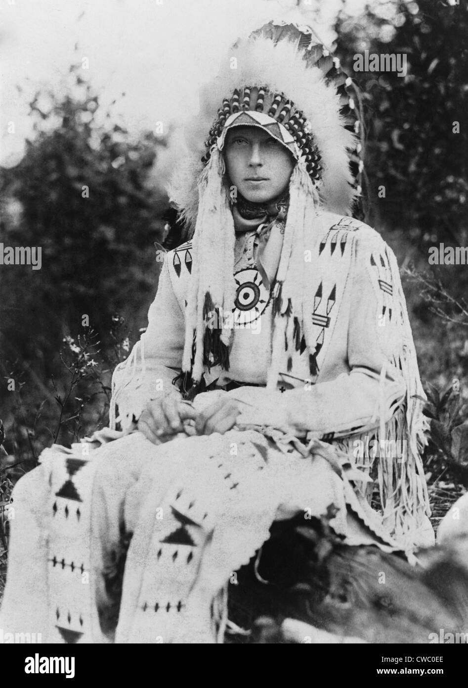 Britain's King Edward VIII as Prince of Wales, wearing the headdress of a Native American chief during a visit to Stock Photo