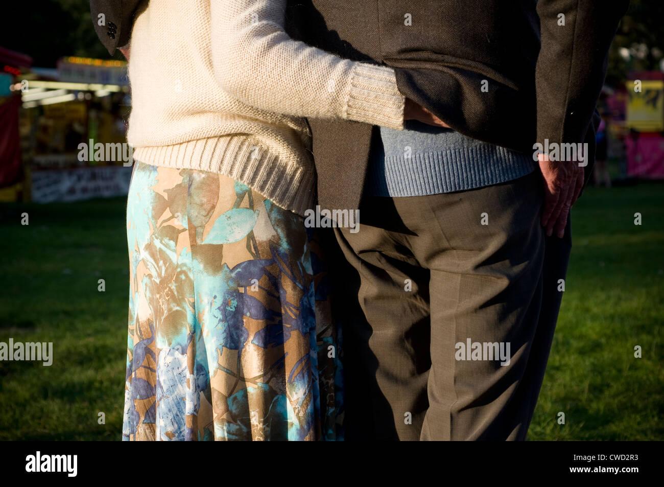 Elderly couple embrace,pickpocket,saga,cuddle,pensioner, adult, arm, back, care, couple, elderly, ,3rd age,ELSA - Stock Image