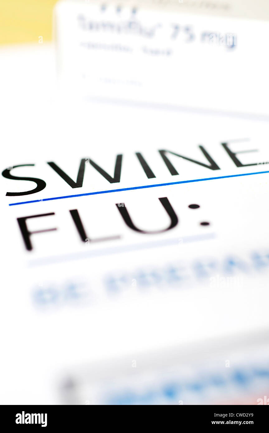 Swine Flu information leaflet in the foreground & box of tamiflu tablets blurred in background - Stock Image