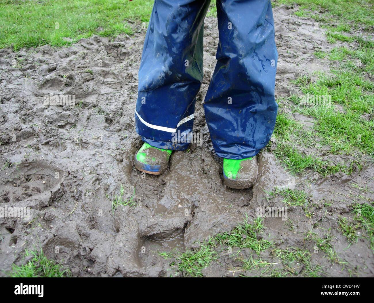mud,galoshes,rain trousers,rainwear - Stock Image