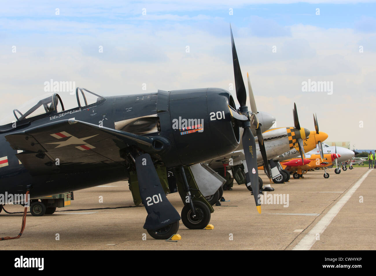 Aircraft lined up along the flight line at Duxford airshow - Stock Image