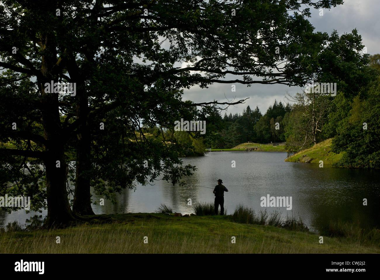 man-fishing-in-ghyll-head-reservoir-near-bowness-south-lakeland-lake-CWJ2J2.jpg