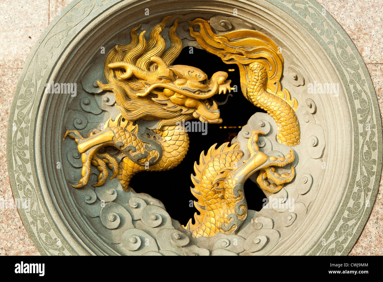 Chinese dragons are mythical creatures in mythology and folklore. In Chinese art they are portrayed as serpentine - Stock Image