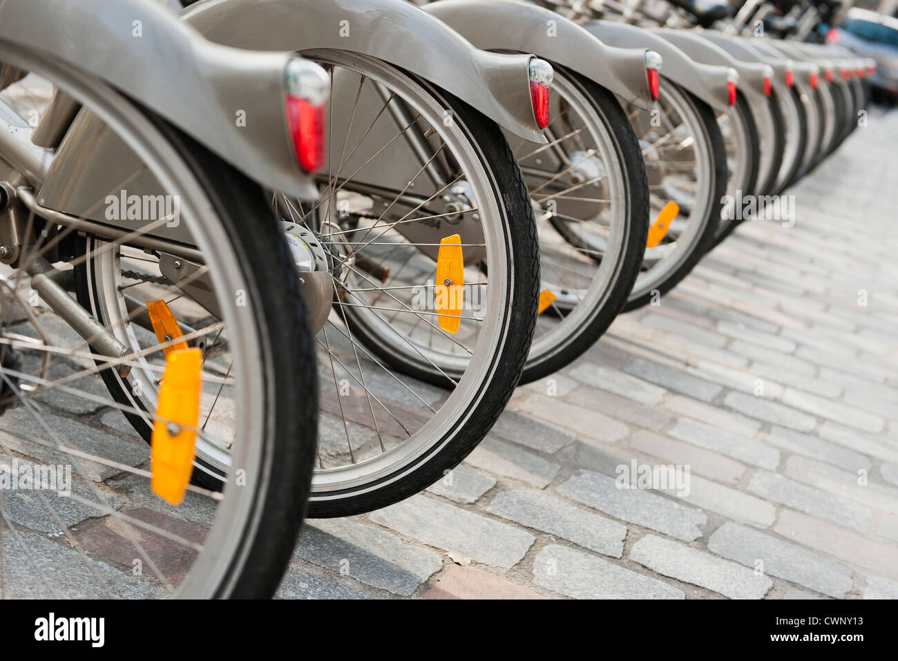 Bicycles parked in a row, cropped - Stock Image