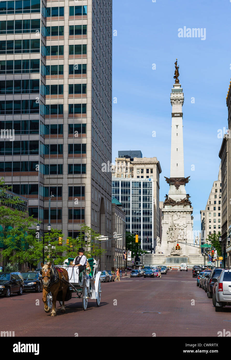 Horsedrawn carriage on W Market Street with Soldiers & Sailors Monument in Monument Circle behind, Indianapolis, - Stock Image