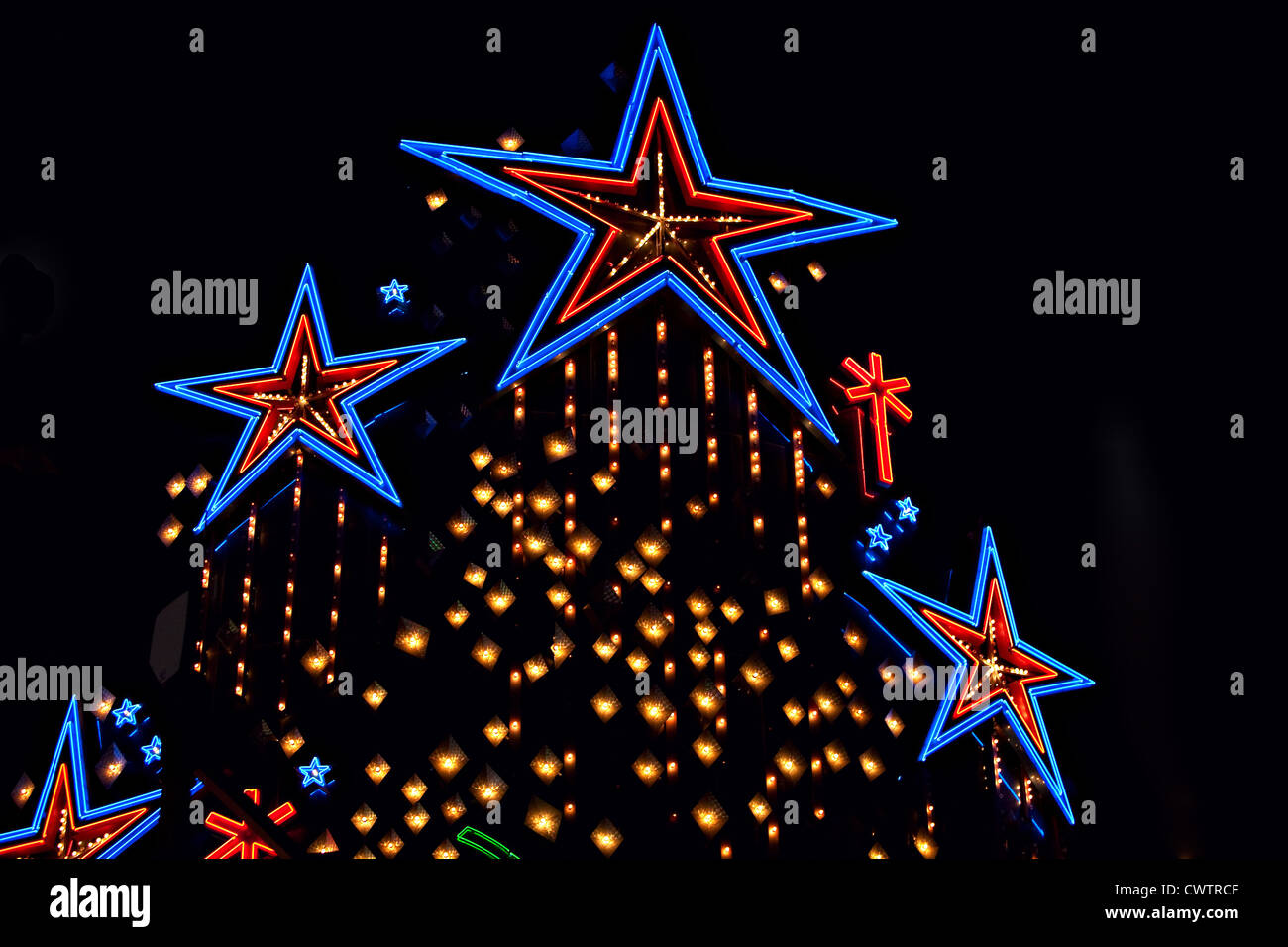 neon stars, bright lights  against a black background - Stock Image