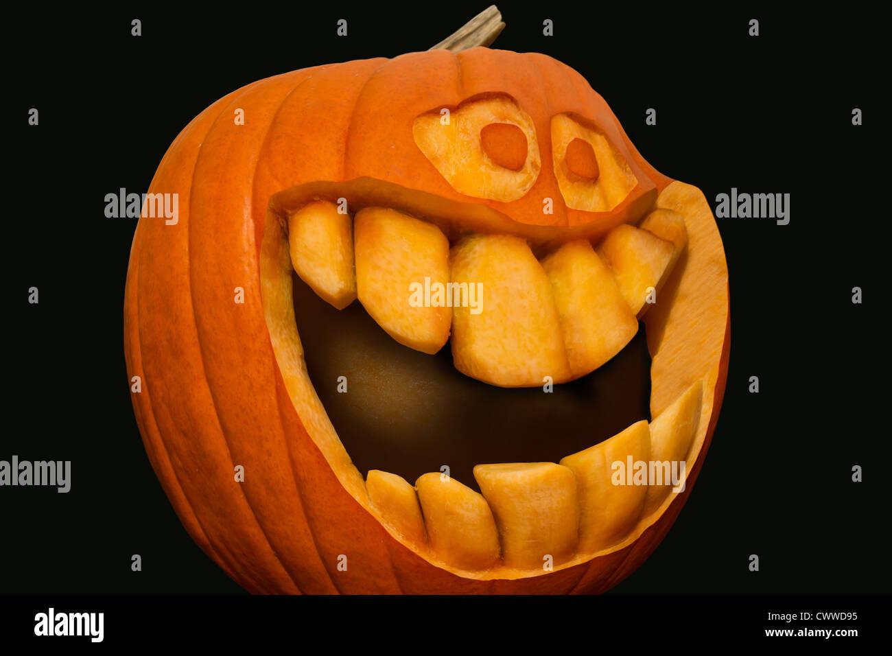 grinning pumpkin with big teeth stock photo royalty free