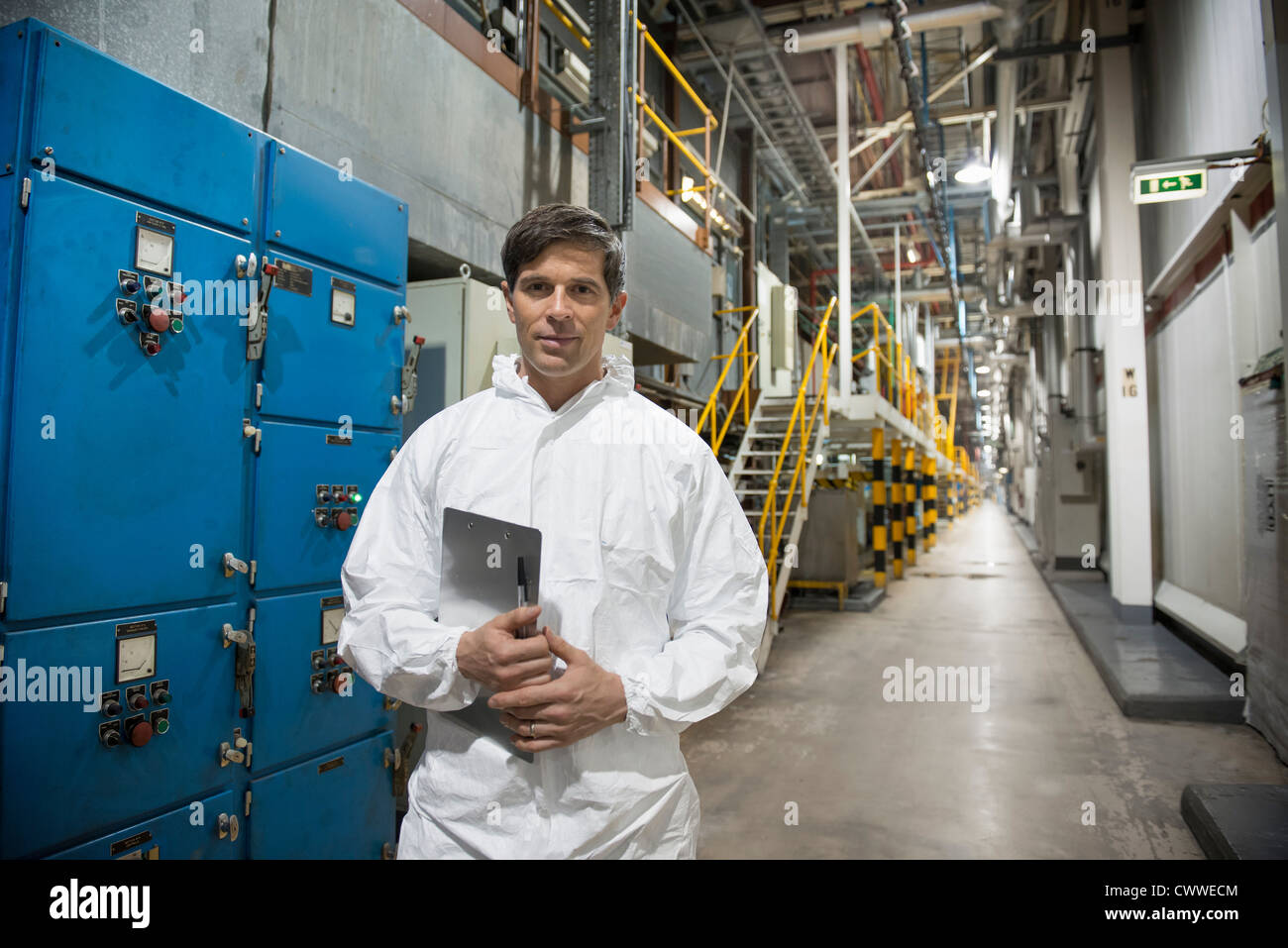 Portrait of spray shop worker in car factory - Stock Image