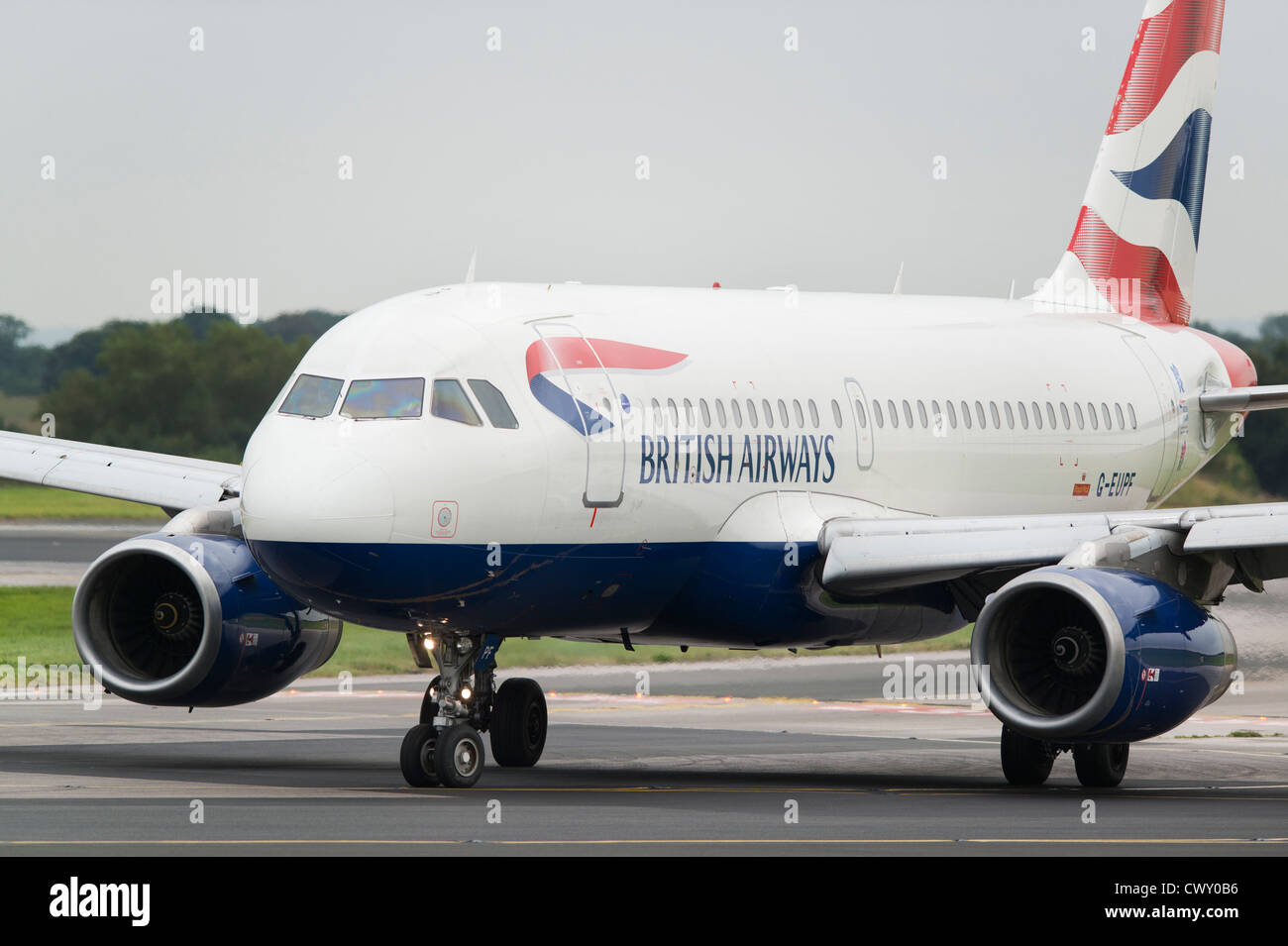 A British Airways Airbus A319 taxiing on the runway of Manchester International Airport (Editorial use only) - Stock Image