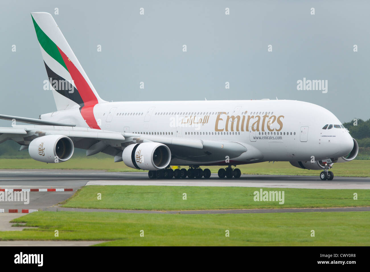 A Emirates Airbus A380 taxiing on the runway of Manchester International Airport (Editorial use only) - Stock Image