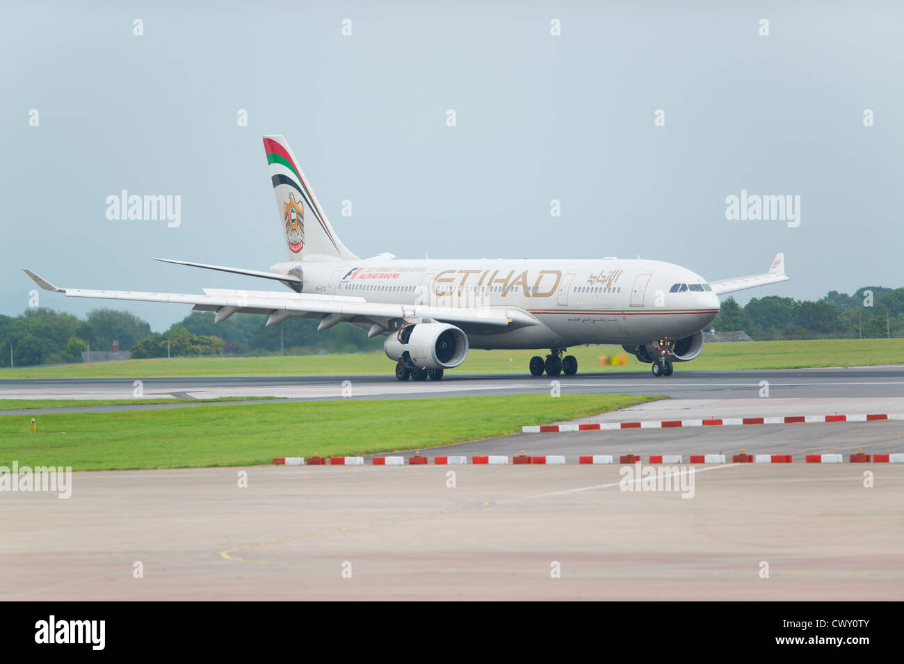 An Etihad Airbus A330 taxiing on the runway of Manchester International Airport (Editorial use only) - Stock Image