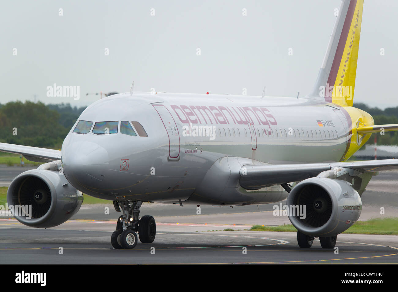 A Lufthansa Germanwings Airbus A319 taxiing on the runway of Manchester International Airport (Editorial use only) - Stock Image