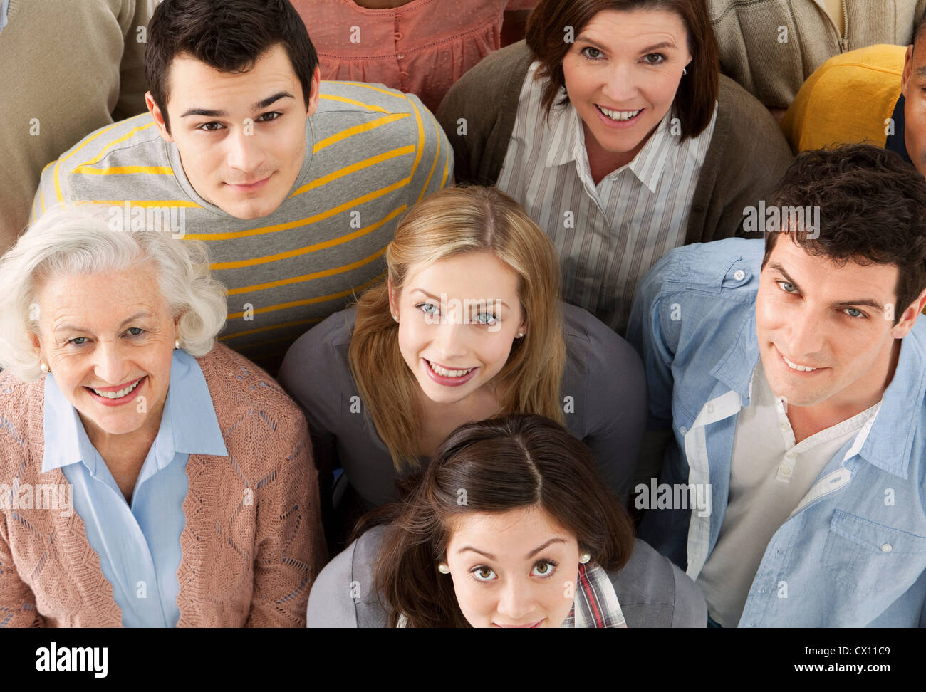 Group of people looking at camera, high angle - Stock Image