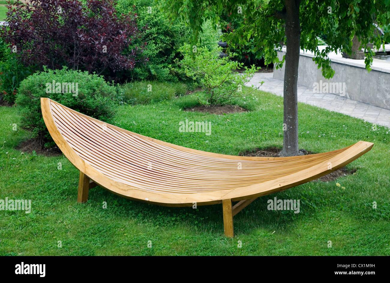 Beau Sleek Modern Garden Furniture Made Of Wood And Varnished.