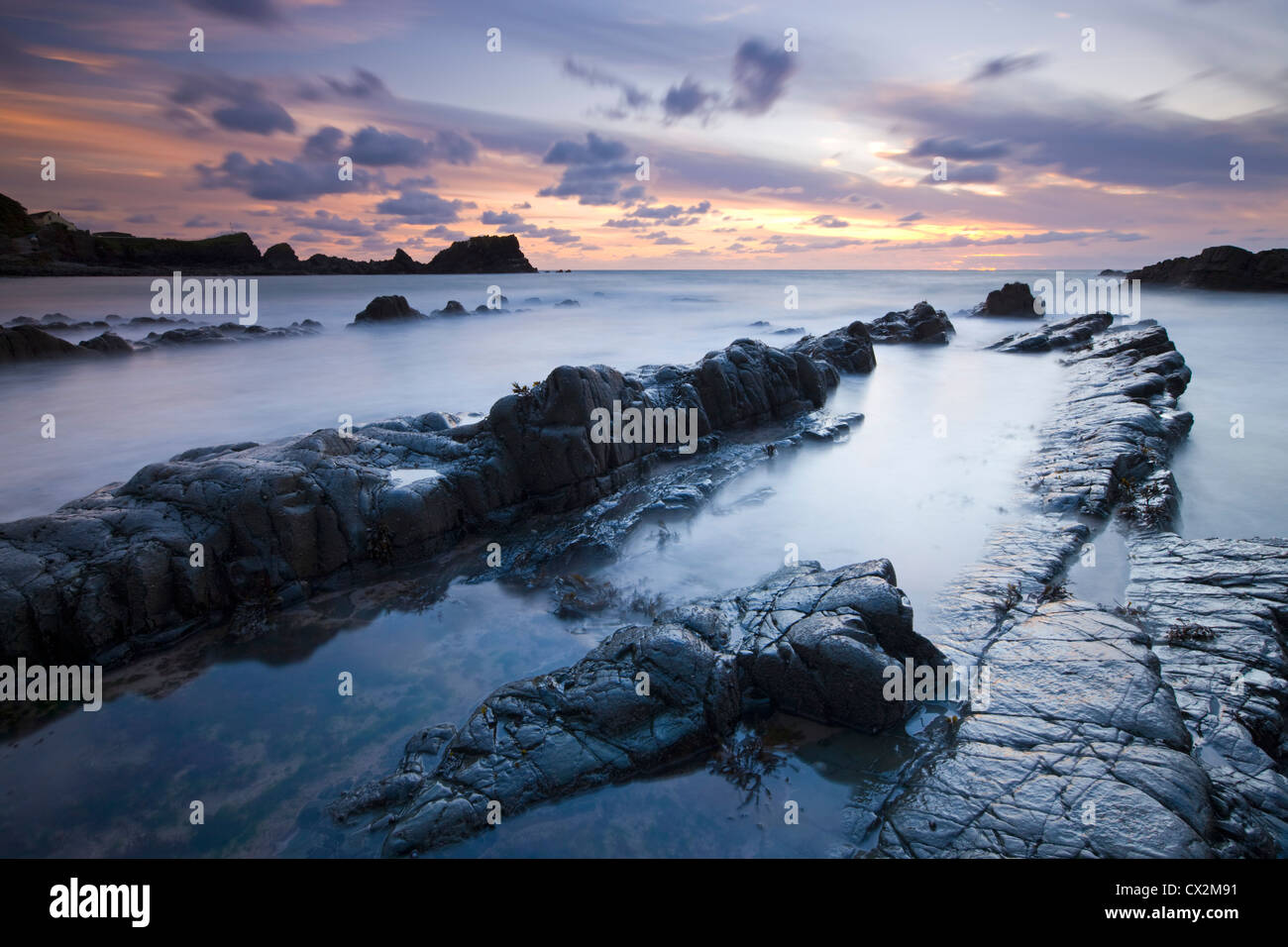 Hartland Quay at dusk from the rocky Quay Beach, North Devon, England. Autumn (September) 2010. - Stock Image