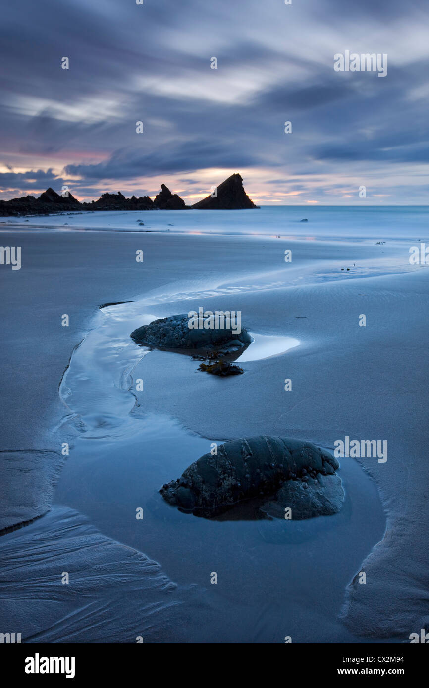 Low tide at dusk on Hartland Quay Beach, North Devon, England. Autumn (September) 2010. - Stock Image